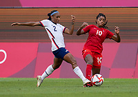 KASHIMA, JAPAN - AUGUST 2: Crystal Dunn #2 of the USWNT tackles the ball away from Ashley Lawrence #10 of Canada during a game between Canada and USWNT at Kashima Soccer Stadium on August 2, 2021 in Kashima, Japan.