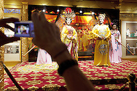 China. Shanghai. World Expo. Expo 2010 Shanghai China.  China Pavilion. A chinese tourist takes a picture with a digital camera of the emperor Tang Ming Huang with his  favorite concubine Lady Yang and her attendants inside the Shanxi pavilion. 25.06.10 © 2010 Didier Ruef