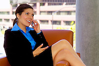 Beautiful woman in business suit with cell phone