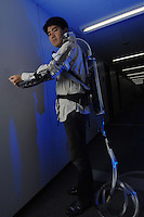 "Dr Hiroshi Kobayashi poses with his ""Muscle Suit"" at the Department of Mechanical Engineering, Tokyo University of Science. The Muscle Suit is a suit that will enable people who are disabled to move their limbs."