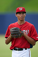 GCL Nationals Michael Cuevas (9) during warmups before a Gulf Coast League game against the GCL Mets on August 12, 2019 at FITTEAM Ballpark of the Palm Beaches in Palm Beach, Florida.  GCL Nationals defeated the GCL Mets 7-3.  (Mike Janes/Four Seam Images)