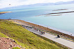The peloton amid stunning scenery during Stage 1 of the 2018 Artic Race of Norway, running 184km from Vadso to Kirkenes, Norway. 16th August 2018. <br /> <br /> Picture: ASO/Rasmus Kongsore | Cyclefile<br /> All photos usage must carry mandatory copyright credit (© Cyclefile | ASO/Rasmus Kongsore)