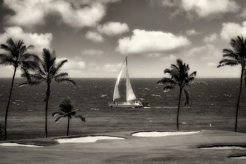 Sailboat and putting green. Hilton Waikoloa Beach Golf Resort. Hawaii, The Big Island