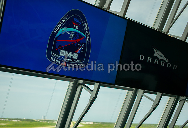 In this photo released by the National Aeronautics and Space Administration (NASA), The Demo-2 mission insignia is seen on a monitor inside firing room four following the launch of a SpaceX Falcon 9 rocket carrying the company's Crew Dragon spacecraft on the Demo-2 mission with NASA astronauts Douglas Hurley and Robert Behnken onboard, Saturday, May 30, 2020, in the Launch Control Center at NASA's Kennedy Space Center in Florida. NASA's SpaceX Demo-2 mission is the first launch with astronauts of the SpaceX Crew Dragon spacecraft and Falcon 9 rocket to the International Space Station as part of the agency's Commercial Crew Program. The test flight serves as an end-to-end demonstration of SpaceX's crew transportation system. Behnken and Hurley launched at 3:22 p.m. EDT on Saturday, May 30, from Launch Complex 39A at the Kennedy Space Center. A new era of human spaceflight is set to begin as American astronauts once again launch on an American rocket from American soil to low-Earth orbit for the first time since the conclusion of the Space Shuttle Program in 2011. <br /> Mandatory Credit: Joel Kowsky / NASA via CNP/AdMedia