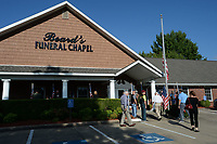 Visitors walk Tuesday, Sept. 14, 2021, into Beard's Funeral Home in Fayetteville to attend a memorial service for 2nd Lt. Henry Donald Mitchell, originally of Harmon. Robert Mitchell, 90, of Fort Smith led a decades long effort to find the remains of his brother, whose plane went down July 8, 1944 over Austria during World War II, and have to them returned to Arkansas for burial. Visit nwaonline.com/210915Daily/ for today's photo gallery.<br /> (NWA Democrat-Gazette/Andy Shupe)