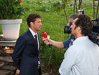 Austria, Kitzbuhel, Juli 15, 2015, Tennis, Davis Cup, Dutch team, Official dinner, Robin Haase being interview by ORF<br /> Photo: Tennisimages/Henk Koster