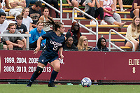 NEWTON, MA - AUGUST 29: Kara Long #15 of University of Connecticut looks to pass during a game between University of Connecticut and Boston College at Newton Campus Soccer Field on August 29, 2021 in Newton, Massachusetts.