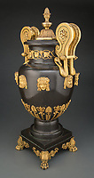 BNPS.co.uk (01202) 558833. <br /> Pic: HeritageAuctions/BNPS<br /> <br /> With video – Download: https://we.tl/t-8OMVmkYQUX<br /> <br /> An extremely rare 19th century vase that had been turned into a glass side table has sold at auction for a whopping £160,000.<br /> <br /> The bronze antique had been made for the British banker Thomas Hope as one of a pair, with the other vase being in the V&A Museum in London. <br /> <br /> Hope commissioned the gilt-bronze pieces for the dining room of his mansion home in London in the early 1800s.