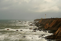The Point Arena Lighthouse stands sentinel on the Northern California Coast, south of Mendocino, during a winter storm in January of 2008. The original Point Arena Lighthouse was damaged in the 1906 Earthquake the United States Lighthouse Service contracted with a San Francisco based company that built factory smokestacks to build a replacement. The new Point Arena Lighthouse began operation in 1908 and was the first lighthouse to be built with steel reinforcement rods encased in concrete to help it withstand an earthquake. Photographed 01/08