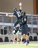 Sean Anderson (21) of  Bentonville and Charles Nimrod (5) celebrates Charles touchdown against Fayetteville at Tigers Stadium, Bentonville, Arkansas on Friday, October 16, 2020 / Special to NWA Democrat-Gazette/ David Beach
