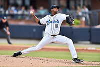 Asheville Tourists starting pitcher Antonio Santos (10 ) delivers a pitch during a game against the Greensboro Grasshoppers at McCormick Field on May 11, 2018 in Asheville, North Carolina. The Tourists defeated the Grasshoppers 10-5. (Tony Farlow/Four Seam Images)