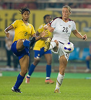 USA forward (20) Abby Wambach tries to take possession of the ball away from Brazil midfielder (5) Renata Costa during their quarterfinal match at Hangzhou Dragon Stadium in Hangzhou, China.  The USA lost to Brazil, 4-0.