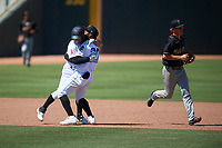 Inland Empire 66ers Leonardo Rivas (3) celebrates with Kevin Williams, Jr. (20) after hitting a walk-off double during a California League game against the Modesto Nuts on April 10, 2019 at San Manuel Stadium in San Bernardino, California. Inland Empire defeated Modesto 5-4 in 13 innings. (Zachary Lucy/Four Seam Images)