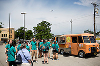 """Members wait in line at a food truck for lunch during """"Circle the City with Service,"""" the Kiwanis Circle K International's 2015 Large Scale Service Project, on Wednesday, June 24, 2015, in Indianapolis. (Photo by James Brosher)"""