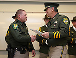 Carson City Sheriff Kenny Furlong, right, presents Deputy Chris Ramos with a life-saving award during a ceremony at the Carson City Sheriff's Office in Carson City, Nev., on Wednesday, April 24, 2013. .Photo by Cathleen Allison
