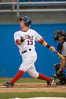 Brian Peacock #13 of the Potomac Nationals follows through on his swing versus the Winston-Salem Dash at Pfitzner Stadium June 10, 2009 in Woodbridge, Virginia. (Photo by Brian Westerholt / Four Seam Images)