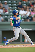 Right fielder Cal Jones (9) of the Lexington Legends swings at a pitch during a game against the Greenville Drive on Saturday, September 1, 2018, at Fluor Field at the West End in Greenville, South Carolina. Greenville won, 9-6. (Tom Priddy/Four Seam Images)