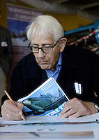 Spitfire pilot Annæus Schjødt (94) signs  posters. Norwegian Spitfire Foundation invited Norwegian WWII  Spitfire veterans to fly in Spitfire, at the historical airfield Kjeller in Norway.