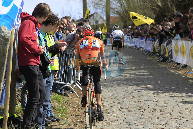 The tail end of the peloton including Adrian Saez (ESP) Euskaltel-Euskadi climbs Koppenberg during the 96th edition of The Tour of Flanders 2012 in Bruges Market Square, running 256.9km from Bruges to Oudenaarde, Belgium. 1st April 2012. <br /> (Photo by Eoin Clarke/NEWSFILE).