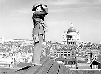 Aircraft spotter on the roof of a building in London with St. Paul's Cathedral in the background.  New York Times Paris Bureau Collection.  (USIA)<br /> Exact Date Shot Unknown<br /> NARA FILE #:  306-NT-901B-3<br /> WAR & CONFLICT BOOK #:  1000
