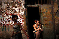 Two women are seen in the streets of Old Havana, Cuba on 13 October 2008.