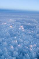 Clouds seen through airplane window<br />