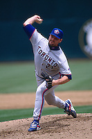 OAKLAND, CA - Roger Clemens of the Toronto Blue Jays in action during a game against the Oakland Athletics at the Oakland Coliseum in Oakland, California in 1997. Photo by Brad Mangin