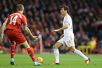 Jack Cork and Jordan Henderson during the Barclays Premier League Match between Liverpool and Swansea City played at Anfield, Liverpool on 29th November 2015