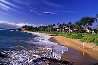 Beachgoers sit, stroll and swim at Wailea, Maui.