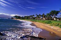 Beachgoers sit, stroll and swim at Wailea, Maui.