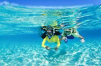 Young teenagers snorkeling in clear Caribbean water<br /> U.S. Virgin Islands
