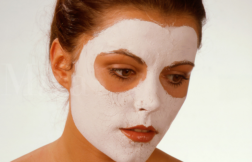 Young woman with face-pack.