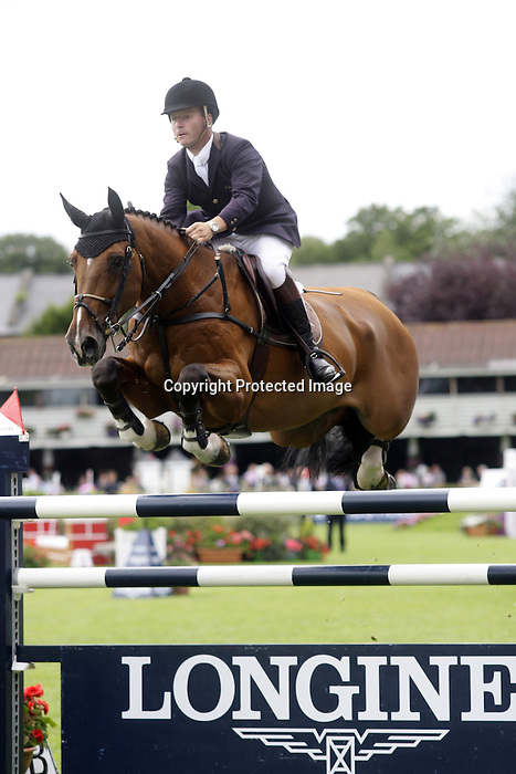August 09, 2009: Leon Thijssen (NED) aboard Olaf competing in the Grand Prix event. Longines International Grand Prix. Failte Ireland Horse Show. The RDS, Dublin, Ireland.
