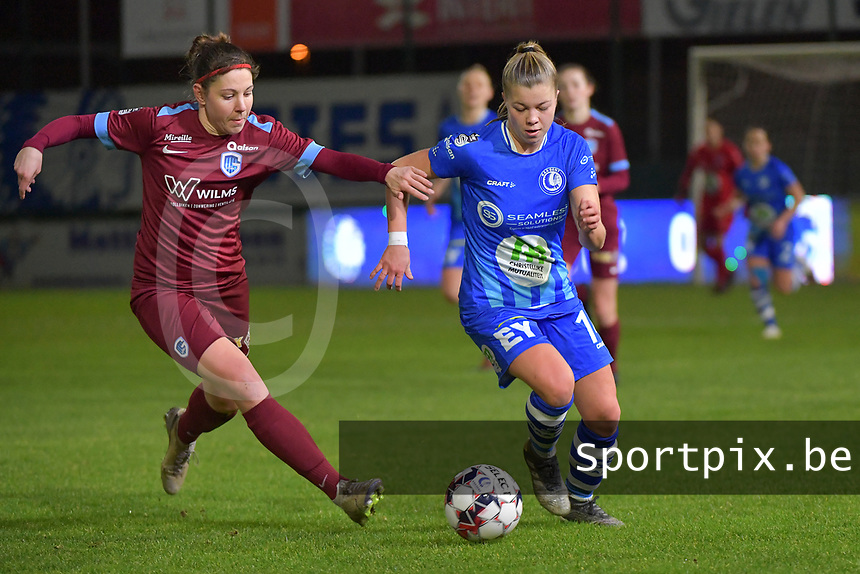 Lyndsey Van Belle (14) of AA Gent and Lorene Martin (4) of KRC Genk pictured during a female soccer game between  AA Gent Ladies and Racing Genk on the 12 th matchday of the 2020 - 2021 season of Belgian Scooore Womens Super League , friday 29 th of January 2021  in Oostakker , Belgium . PHOTO SPORTPIX.BE   SPP   DIRK VUYLSTEKE