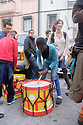 "Lisbon, Portugal. 21.03.2015. A ""Batucada"" Tavern Crawl is held in the Mouraria district of Lisbon. People gather to make music in the streets, accompanied by percussion instruments such as drums, tambourines, etc. whilst revellers follow, dancing, singing, eating and drinking and others watch on from their balconies. ""Batucada"" is a Brazilian form of accompaniment to music such as Samba. It comes from the verb ""Batucar"" which means ""to hammer"". The event is part of a community effort to improve the local area by Mouradia – Casa Comunitária da Mouraria. Picture shows a young boy, having a turn on a drum. Photograph © Jane Hobson."