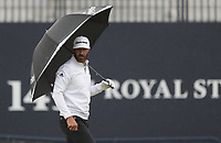 12th July 2021; The Royal St. George's Golf Club, Sandwich, Kent, England; The 149th Open Golf Championship, practice day; Dustin Johnson (USA) uses an umbrella to shelter from the rain