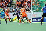 The Hague, Netherlands, June 14: During the field hockey gold medal match (Women) between Australia and The Netherlands on June 14, 2014 during the World Cup 2014 at Kyocera Stadium in The Hague, Netherlands. Final score 2-0 (2-0)  (Photo by Dirk Markgraf / www.265-images.com) *** Local caption *** Madonna Blyth #12 of Australia, Kim Lammers #23 of The Netherlands, Rachael Lynch #27 of Australia, Lidewij Welten #12 of The Netherlands