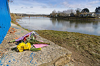 Pictured: Flowers left at the slipway where the Mini car with Kiara Moore entered river Teifi from in Cardigan, west Wales, UK. Tuesday 20 March 2018<br /> Re: The funeral of two year old Kiara Moore, who died after being recovered from a silver Mini car found in river Teifi in Cardigan will be held today (Tue 27 Mar 2018) at Parc Gwyn Crematorium, Narberth, west Wales.<br /> Kiara was taken at the University Hospital of Wales in Cardiff after being rescued but was pronounced dead.<br /> It is believed the car she was in, rolled down a slipway while her mother got out momentarily to get cash out of the family business premises.<br /> Her parents Jet Moore and Kim Rowlands have expressed their grief on social media.