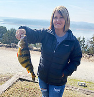 Sharon Christopher shows the Missouri state record yellow perch she caught at Bull Shoals Lake.<br />(Courtesy photo)