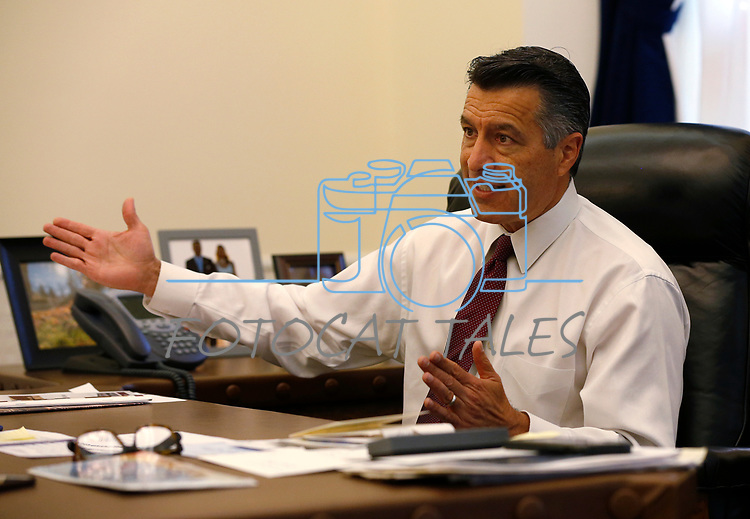 Nevada Gov. Brian Sandoval, who left a lifetime appointment to the federal bench, looks back on eight years as Governor from his office at the Capitol, in Carson City, on Monday, Dec. 17, 2018. (Cathleen Allison/Las Vegas Review-Journal)