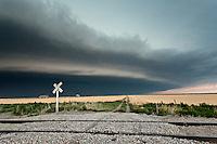 Thunderstorm Shelf Cloud Above Yellow Wheat Field w/ Railroad Tracks near Goodland, KS, June 15, 2012