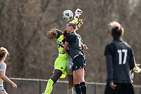 LOUISVILLE, KY - MARCH 13: Brooke Hendrix #15 of Racing Louisville FC goes up for a header as Kayza Massey #00 of West Virginia University blocks a goal shot during a game between West Virginia University and Racing Louisville FC at Thurman Hutchins Park on March 13, 2021 in Louisville, Kentucky.