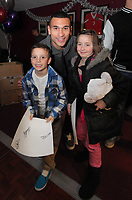 Pictured:  Stephen Caulker (C) with two young supporters. Thursday 15 December 2011<br /> Re: Children  have who have been treated at the burns unit of Morriston Hospital have met Swansea City FC players at the Liberty Stadium.