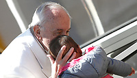 Papa Francesco bacia una bambina al termine dell'udienza generale del mercoledi' in Piazza San Pietro, Citta' del Vaticano, 19 aprile, 2017.<br /> Pope Francis kisses a child at the end of his weekly general audience in St. Peter's Squareat the Vatican, on April 19 2017.<br /> UPDATE IMAGES PRESS/Isabella Bonotto<br /> <br /> STRICTLY ONLY FOR EDITORIAL USE