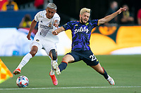 CARSON, CA - JUNE 19: Julian Araujo #2 of the Los Angeles Galaxy and Kelyn Rowe #22 of the Seattle Sounders battle for a loose ball during a game between Seattle Sounders FC and Los Angeles Galaxy at Dignity Health Sports Park on June 19, 2021 in Carson, California.