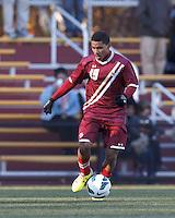 Boston College forward/midfielder Zeiko Lewis (19) brings the ball forward. Boston College (maroon) defeated Virginia Tech (Virginia Polytechnic Institute and State University) (white), 3-1, at Newton Campus Field, on November 3, 2013.