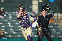 Western Carolina Catamounts catcher Kitt Capell (12) and home plate umpire Anthony Perez rip off their masks during the game against the Saint Joseph's Hawks at TicketReturn.com Field at Pelicans Ballpark on February 23, 2020 in Myrtle Beach, South Carolina. The Hawks defeated the Catamounts 9-2. (Brian Westerholt/Four Seam Images)