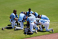 FCL Rays players huddle before a game against the FCL Twins on July 20, 2021 at Charlotte Sports Park in Port Charlotte, Florida.  (Mike Janes/Four Seam Images)