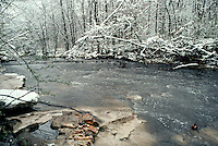 snow melt in very early spring after a snow fall with creeks running high, Missouri USA