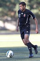 Brown University midfielder Tariq Akeel (15) at midfield. Brown University (black) defeated Boston College (white), 1-0, at Newton Campus Field, October 16, 2012.